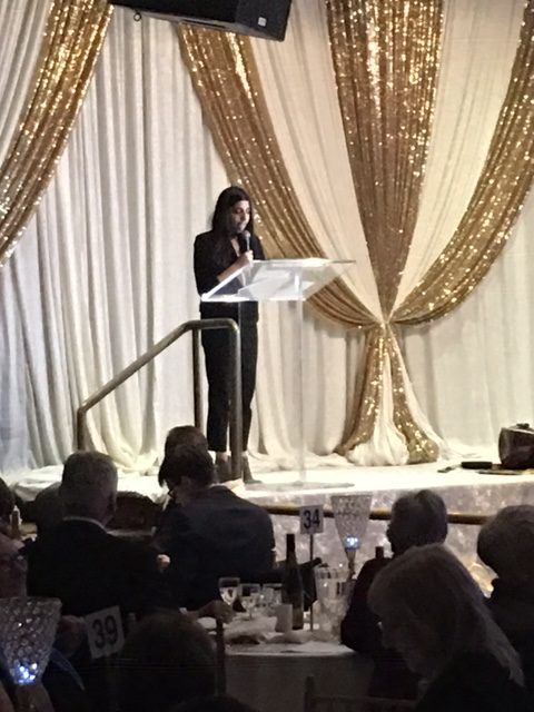 Raheesa giving a speech at the Two Worlds Cancer Collaboration Rhythm of India Fundraiser